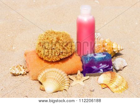 Spa Beach Products On The Sand: Towel, Soap, Bottle, Starfish, Shells