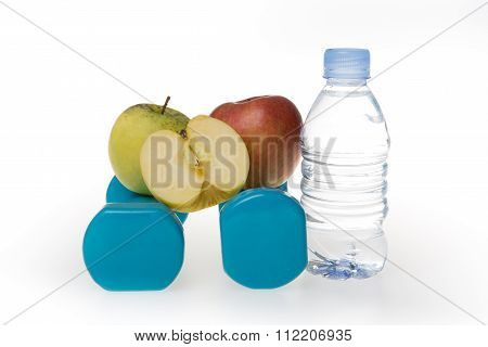 Bottle With Water, Dumbell And Green And Red Apple Isolated