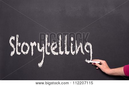 Woman's Hand With Chalk On Blackboard Writing, Storytelling
