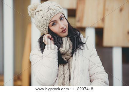 Portrait of a beautiful brunette outdoors in late autumn