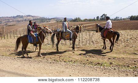 JELDU, ETHIOPIA-APRIL 23, 2015: Unidentified men ride horseback to a wedding in the highlands of Ethiopia