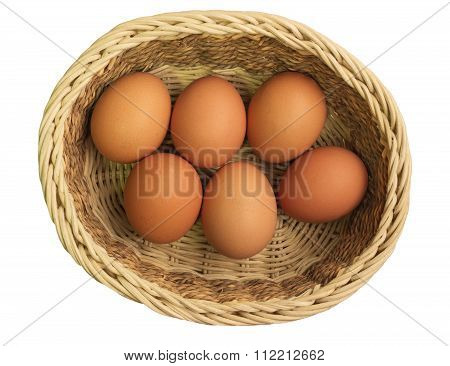 Eggs in a wicker basket on a white background
