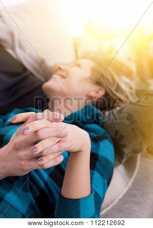 Girl In Love Lying With Head In Boyfriend Lap