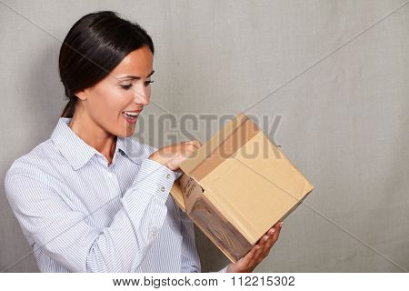 Well-dressed Female With Open Mouth Opening Box