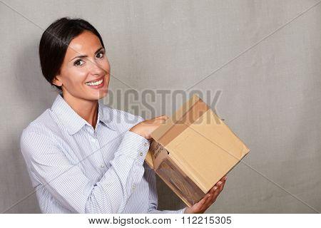 Caucasian Ethnicity Female Opening A Parcel