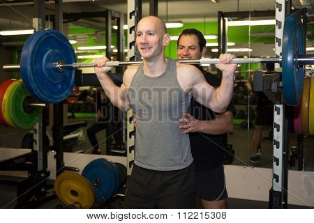 Gym Sporty Man Posing With Barbell -squat