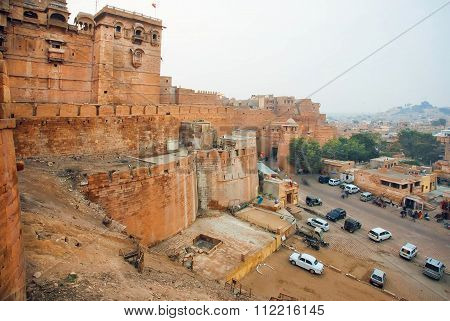 Cars Parking Under The Jaisalmer Fort, One Of The Largest Fortifications In The World, India