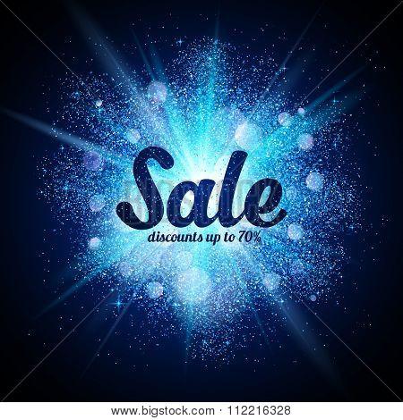 Sale sign on blue glitter cosmic splash at dark background