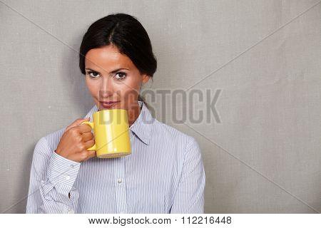 Long Hair Businesswoman Holding Yellow Mug