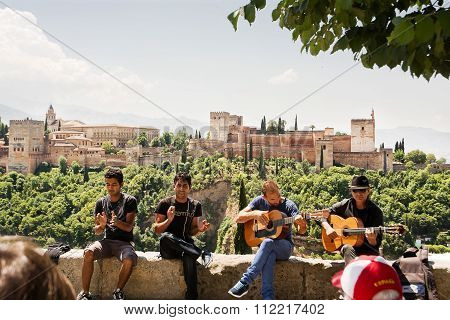 Gypsy Musicians To Granada And The Alhambra In The Background