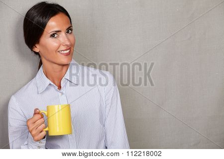 Smiling Young Lady Holding Hot Drink