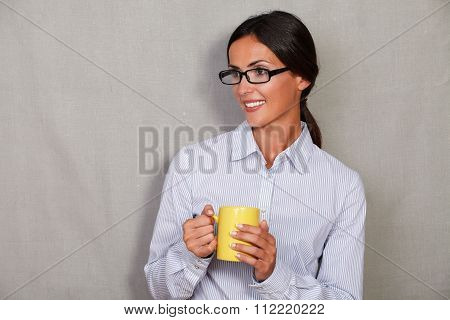 Smiling Lady Wearing Glasses And Holding Hot Drink