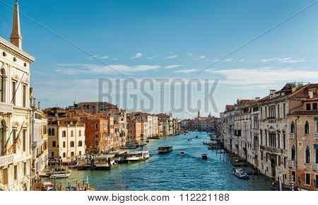 Scenic view on a sunny day along the Grand Canal, Venice from one of the palazzo lining the canal showing the busy traffic with vaporetti water buses and boats