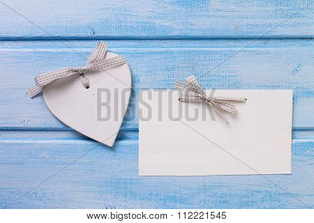 Decorative Heart And Empty Tag On Blue Painted Wooden Background.