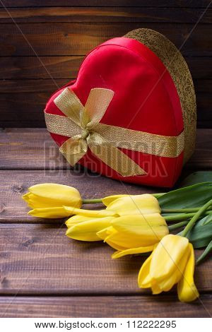 Bright Yellow Flowers Tulips And Festive Gift Box In Form Of Heart