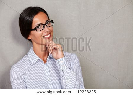 Well-dressed Female With Glasses And Hand On Chin
