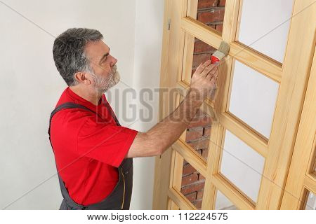 Home Renovation, Worker Painting Wooden Door, Varnishing