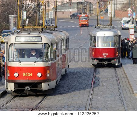 Three Red And White Vintage Tram And People