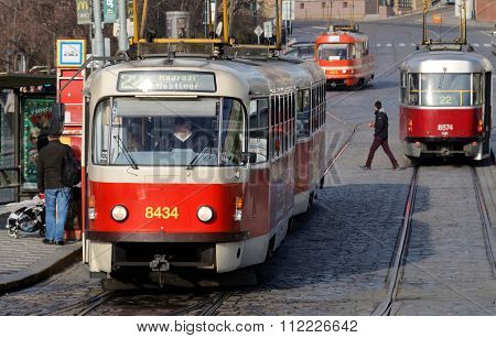 Three Red And White Vintage Tram