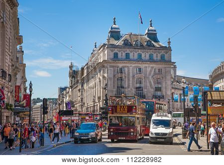 LONDON, UK - MAY 14, 2015: People and traffic in Piccadilly Circus in London. Famous place for roman