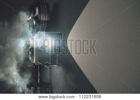 Vintage Movie Camera In The Fog And Grey Wall