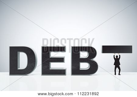 Debt Burden Concept With Debt Word And Businessman Holding Instead T