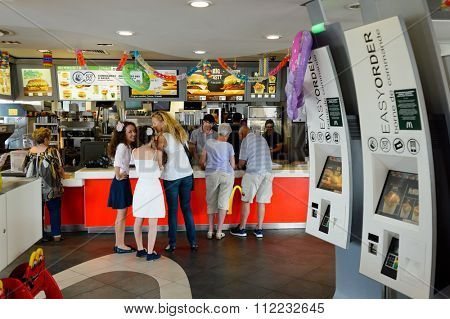 LE PIAN-MEDOC, FRANCE - AUGUST 13, 2015: interior of McDonald's restaurant. McDonald's is the world's largest chain of hamburger fast food restaurants, founded in the United States.