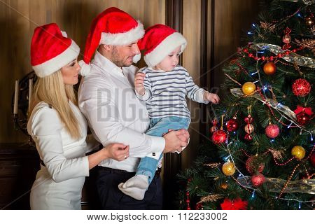 Happy Family And Christmas Tree.