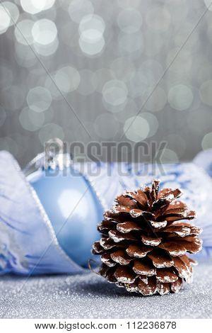 Christmas pinecone on shiny background