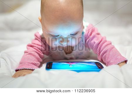 Baby girl watching cartoon on the mobile phone