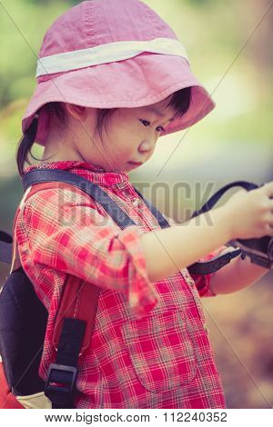 Asian Girl Checking Photos In Digital Camera. Vintage Picture Style.