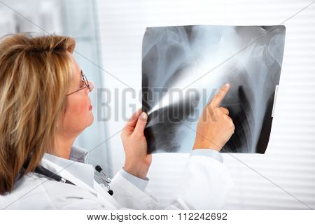 Mature doctor woman in a clinical office. Health care concept.