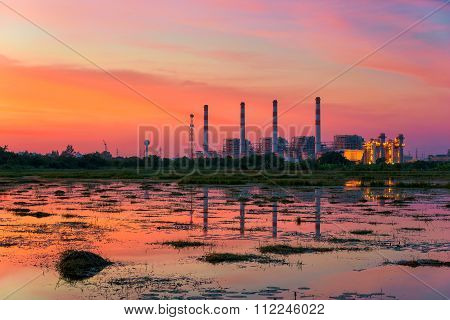 Industrial power plant at sunset.