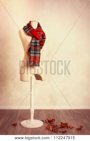 Winter tartan scarf with falling autumn leaves