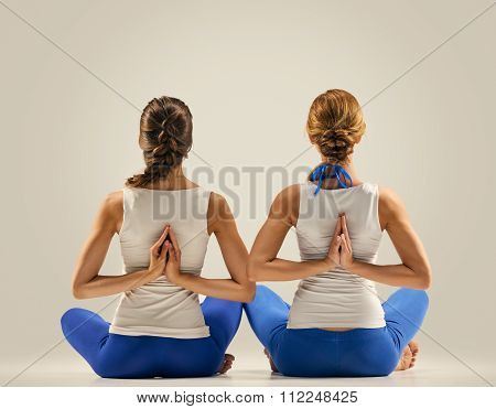 yoga in pair. stretching. back. seated