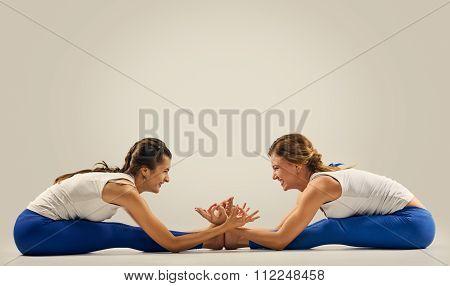 Women pair yoga. Seated Forward Bend