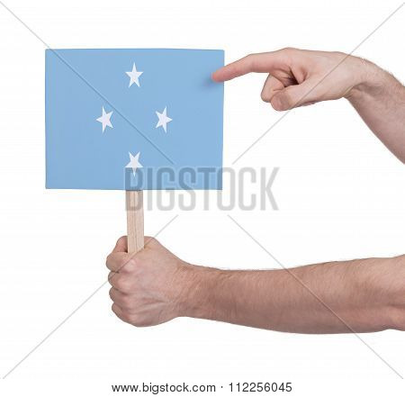 Hand Holding Small Card - Flag Of Micronesia