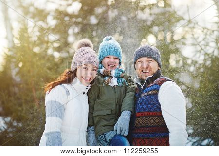 Ecstatic family enjoying time in winter park