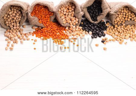 Bowls Of Various Legumes On Wooden Background,healthy Food,vegan Food.