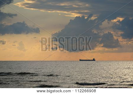 Ship Sailing At Sunset