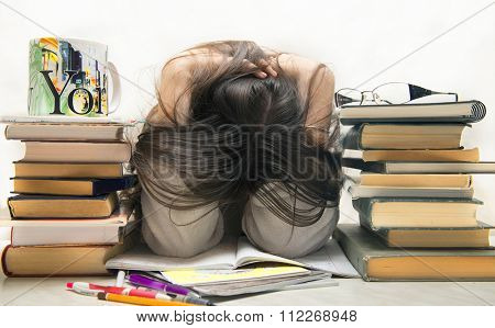 people, education, session, exams and school concept - tired student girl or young woman with books sleeping