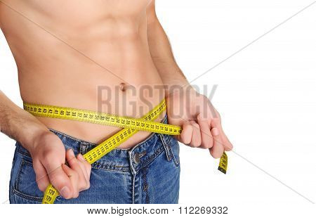 Young man measuring her waist