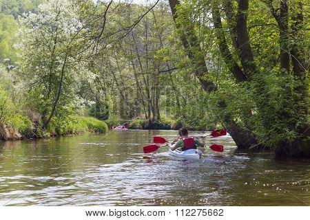 Kayaking on the river Kamienna near Baltow, Poland