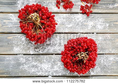 Bunches of guelder-rose on wooden background