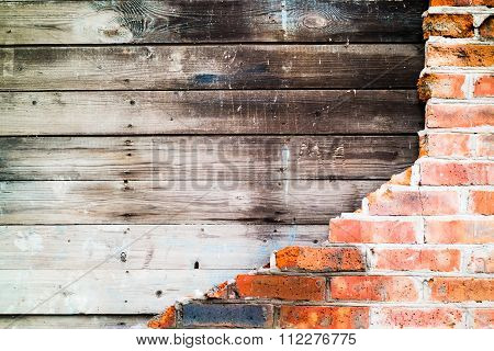 brick wall collapsed revealing old boards