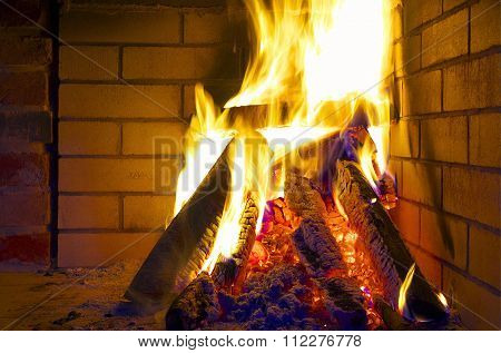 Burning Logs In Fireplace.