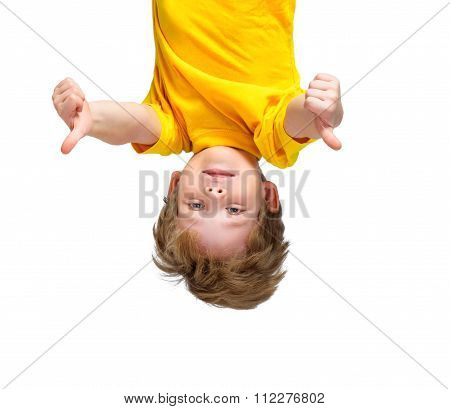 Handsome little boy hanging upside down