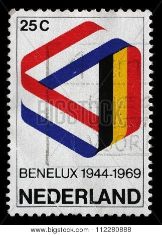 NETHERLANDS - CIRCA 1969: a stamp printed in the Netherlands shows Mobius Strip in Benelux Colors, 25th Anniversary of the Signing of the Customs Union, circa 1969