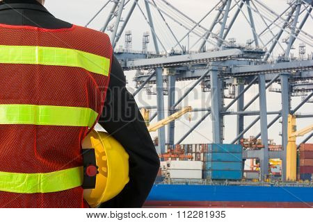 Hand Or Arm Of Engineer Hold Yellow Plastic Helmet