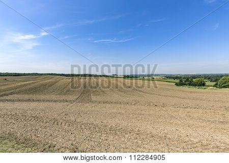 Landscape With Arable Land Forest And Blue Sky
